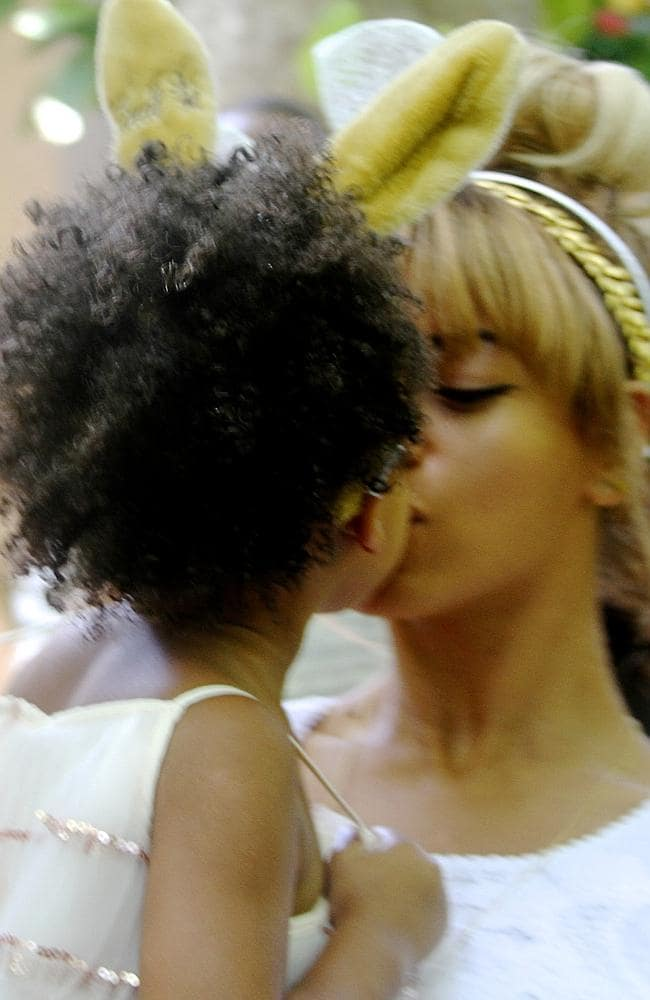 Blue Ivy and Beyonce share a kiss.