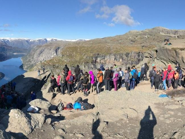 """Tourists wait in a queue for hours to take a quick photo. Photo:  <a href=""""https://www.tripadvisor.com.au/Attraction_Review-g1096319-d3522548-Reviews-or30-Trolltunga-Odda_Hardanger_Hordaland_Western_Norway.html"""" title=""""www.tripadvisor.com.au"""">TripAdvisor Traveller</a>"""