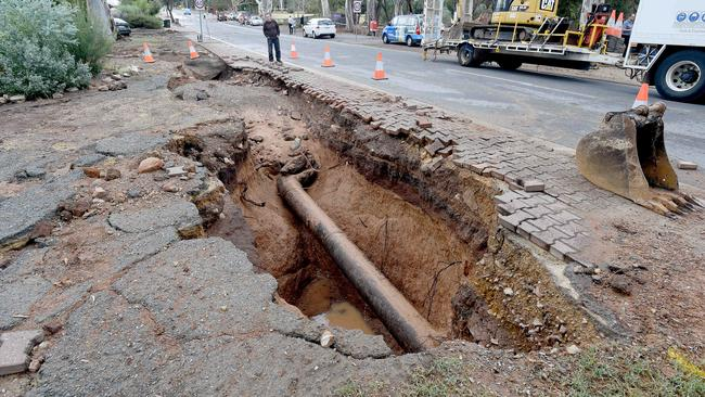 A massive hole is left after a burst water main in Athelstone. Photo: Naomi Jellicoe
