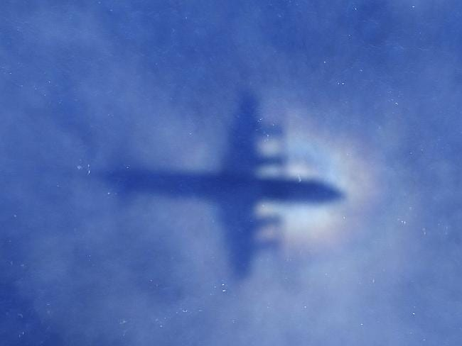 Mystery ... A shadow of a RNZAF P3 Orion aircraft is seen on low cloud cover while it sea