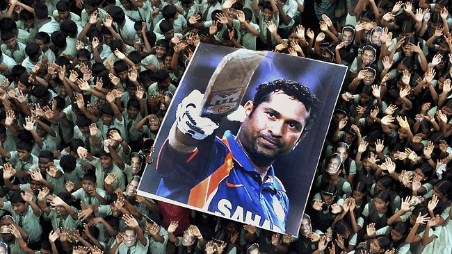 Indian students hold a large poster of Indian cricketer Sachin Tendulkar after Tendulkar batted for his landmark 100th century, at a school in Chennai, southern India, in 2012.