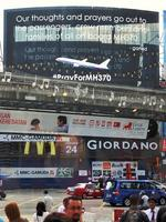 An electronic billboard displays a message about the missing Malaysian Airlines flight MH370 on March 23, 2014 in Kuala Lumpur. Picture: Rufus Cox/Getty Images