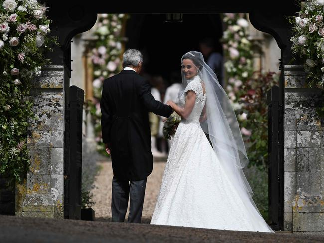 Pippa Middleton escorted by her father Michael Middleton for her wedding to James Matthews at St Mark's Church in Englefield. Picture: Justin Tallis
