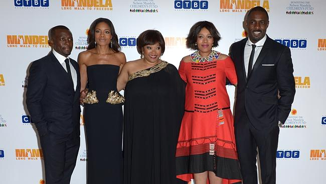 From left to right, Tony Kgoroge, Naomie Harris, Zindzi Mandela, her sister Zenani, and Idris Elba pose for photographers at the UK Premiere of 'Mandela: Long Walk To Freedom' at the Odeon Leicester Square in London on Thursday Dec. 5, 2013