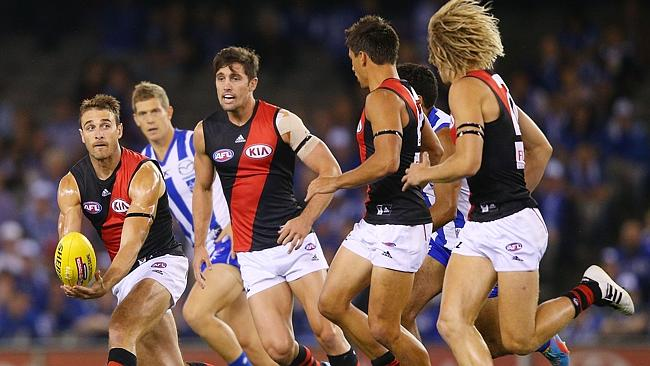Jobe Watson of the Bombers handpasses the ball during the Round 1. Photo by Michael Dodge