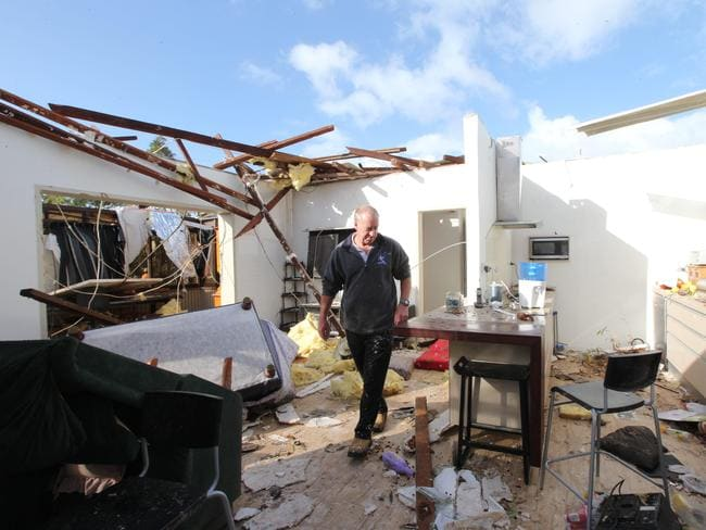 The scene of storm damage in Clarke Street, O'Connor. Wayne looks at the damage to the living and kitchen areas of his parents, Noel and Shirley Nicholas' home. Picture: Ross Swanborough