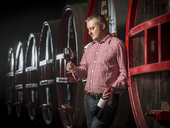 Penfolds global ambassador Jamie Sach with a bottle of St. Henri in the St. Henri Cellar at Penfolds Magill Estate.