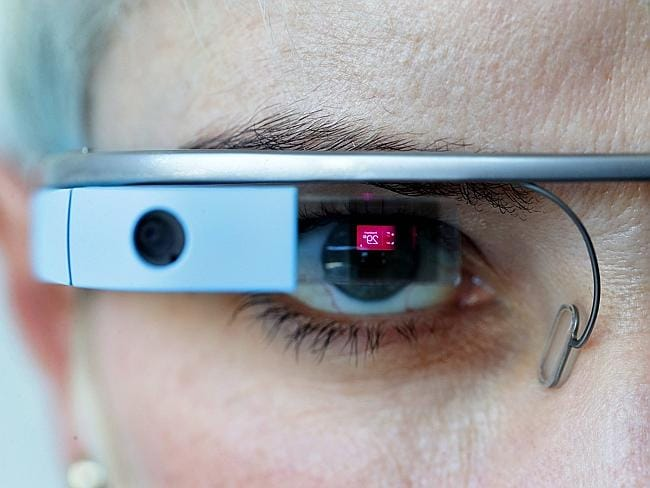 The glasses let you browse the internet on the go. Above, Cathie Reid trials a pair on th