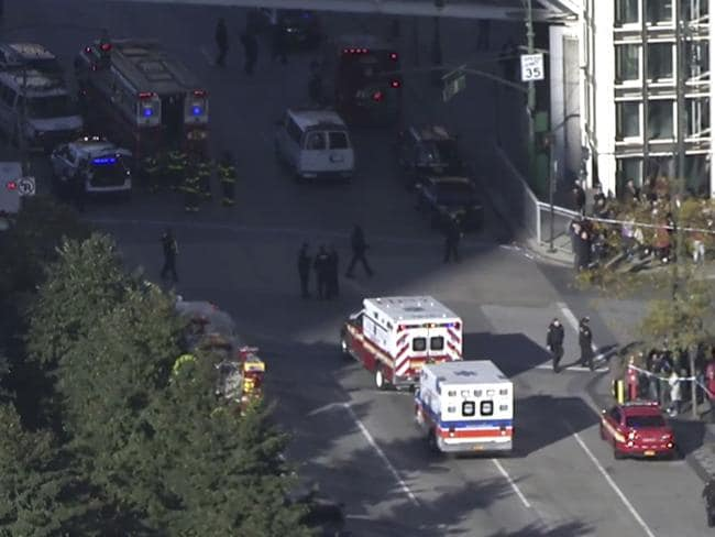 Police and ambulances respond to reports of gunfire a few blocks from the World Trade Center in New York. Picture: AP Photo