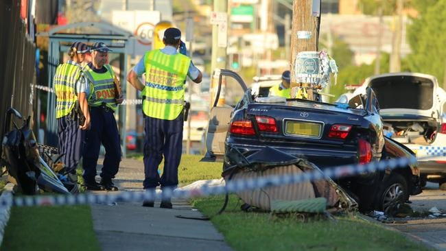 The mangled wreck of the Toyota Aurion after it struck a pole in Belmore, killing one man and injuring two others. Picture: John Grainger