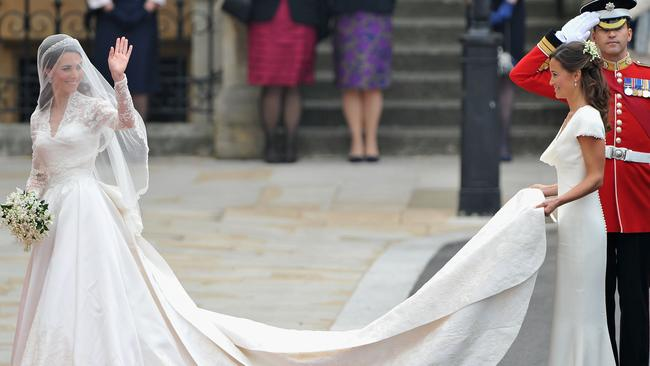 Kate Middleton in a Sarah Burton design for Alexander McQueen, with bridesmaid sister, Pippa. Picture: Getty