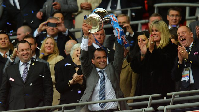 FA CUP FINAL. Wigan Athletic 1 d Manchester City 0 at Wembley. Wigan manager Roberto Martinez lifts the trophy. Picture: Shaun Botterill