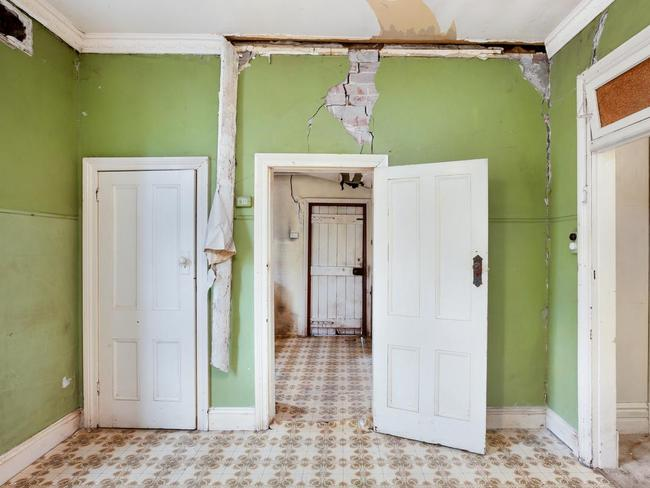 This Homebush house has plenty of work to do with caved in ceilings and was listed for $2.1m but may go for less. Picture: realestate.com.au.
