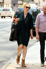 Cate Blanchett, wearing a blue shirt dress and suede ankle boots pounds the pavement in NYC. Picture: Splash