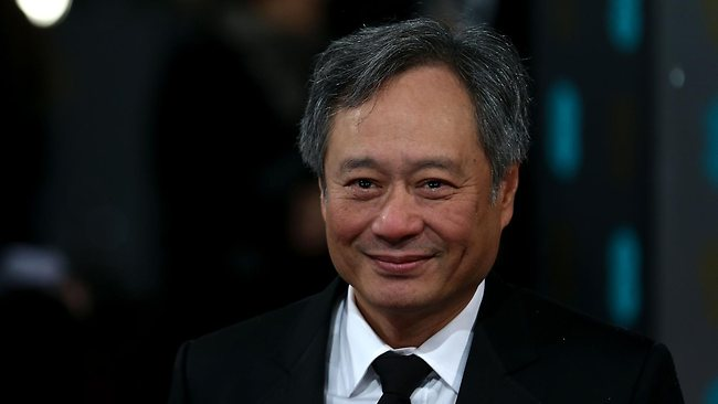 Taiwanese born US director Ang Lee poses for photographs on the red carpet as he arrives for the BAFTA British Academy Film Awards at the Royal Opera House in London on February 10, 2013. AFP PHOTO/Andrew COWIE