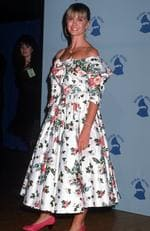 Australia's own Olivia Newton John could have been mistaken for your granny's couch at the 1989 Grammy Awards. Picture: Ron Galella/WireImage