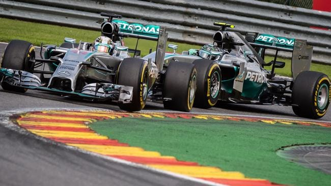 Mercedes drivers Lewis Hamilton (L) and Nico Rosberg before their collision on the second lap at Spa.