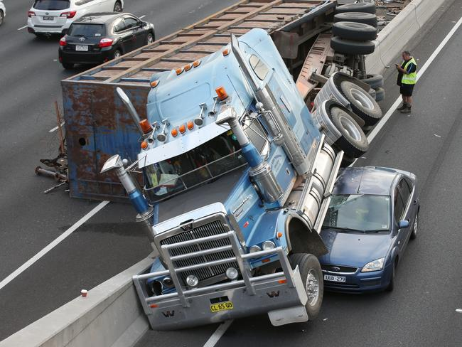 The truck hit a concrete barrier and came to rest on top of a car. Picture: David Crosling.