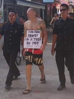 A tourist is paraded on the island with a sign reading: 'I am from France. I am a thief. Do not trust me!' Picture: Facebook/Gili Trawangan, Meno, Air