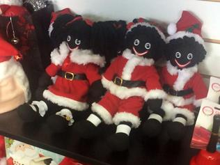 "Santa Golly Dollies on display at a store in Melbourne, Monday, Oct. 24, 2016. Victorian stores are selling out of these locally made ""Santa Golly Dollies"", despite them being considered racist stereotypes. (AAP Image/Kaitlyn Offer) NO ARCHIVING"