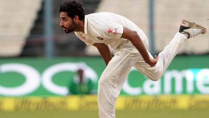 India's Bhuvneshwar Kumar bowls during the second day of the second Test match between India and New Zealand at The Eden Gardens Cricket Stadium in Kolkata on October 1, 2016. Fast bowler Bhuvneshwar Kumar claimed five wickets to leave New Zealand tottering at 128 for seven at stumps as India gained the upper hand in the second Test on a rain-hit day two in Kolkata.----IMAGE RESTRICTED TO EDITORIAL USE - STRICTLY NO COMMERCIAL USE----- / GETTYOUT / AFP PHOTO / Dibyangshu SARKAR