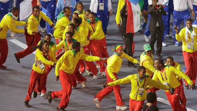 Athletes get into the spirit of the closing ceremony as they enter the Olympic Stadium.