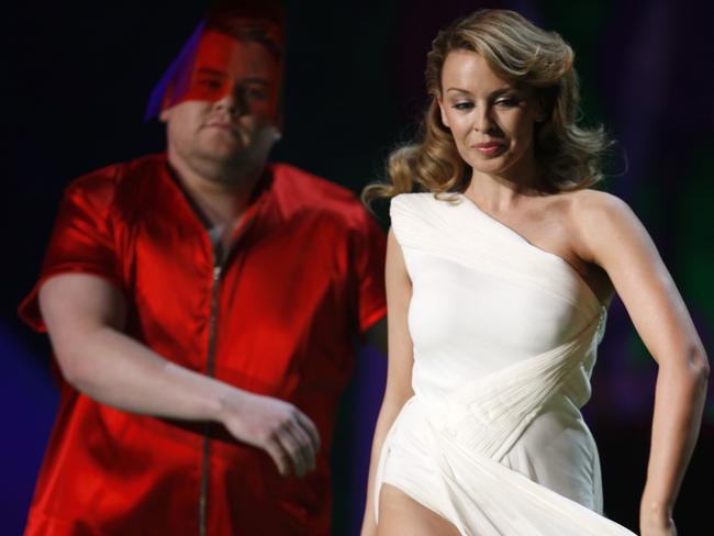 Hosts Kylie Minogue and Corden perform at the 2009 Brit Awards in London. Picture: AP