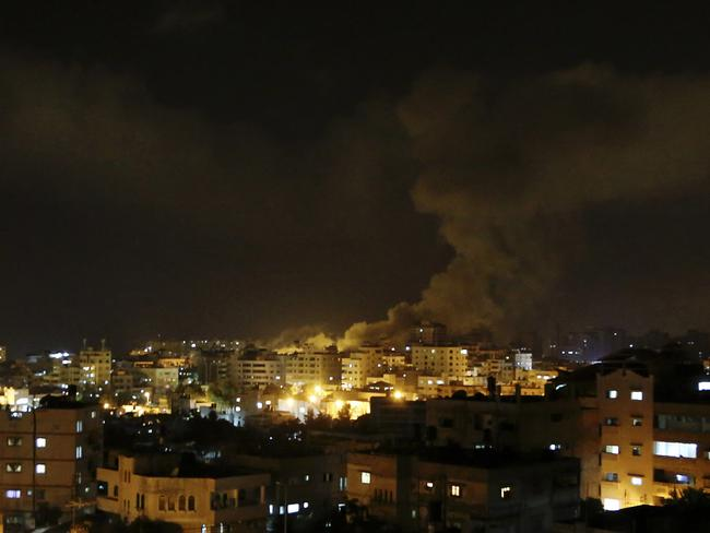 Israeli air strikes ... Gaza City burns after an Israeli missile attack on July 3. Picture: AP