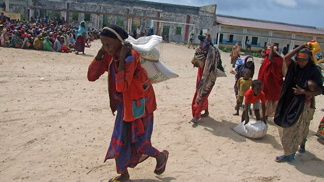 Somali women from southern Somalia walk after receiving rations at a displaced camp in Mogadishu. Tens of thousands of Somalis have already died in the worst hunger emergency in a generation.Picture: AP