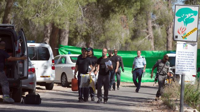 Body found ... Israeli policemen search the area after a body of a Palestinian youth was found in Jerusalem's forest area. Picture: MENAHEM KAHANA