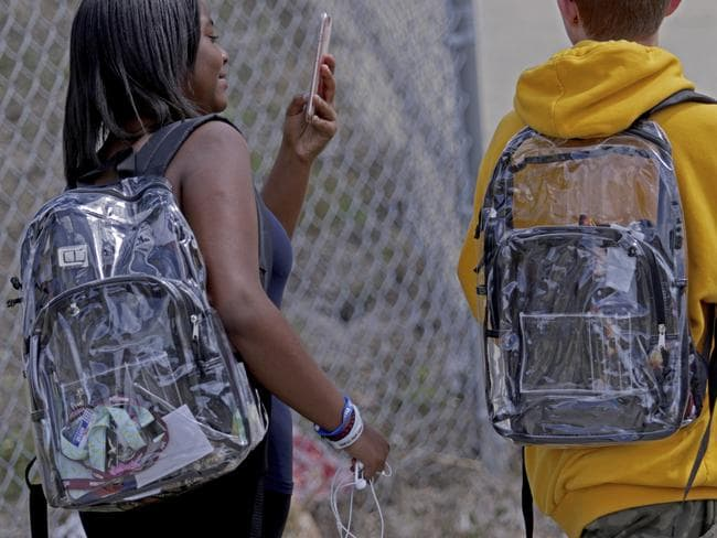 Students wear clear backpacks outside of Marjory Stoneman Douglas High School in Parkland. Picture: AP