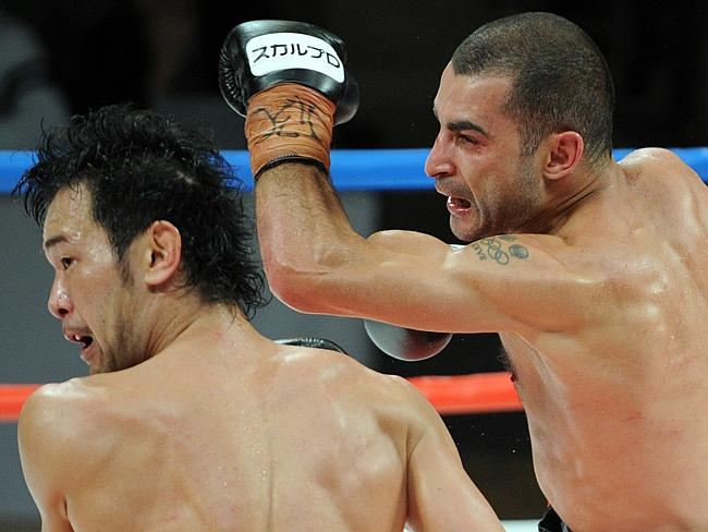 Vic Darchinyan strikes Shinsuke Yamanaka with a left hook during their title fight in Tokyo in 2012.