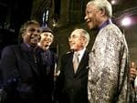"""PIRATE: SEPTEMBER 3, 2000 : Former South African President Nelson Mandela (R) with L-R Yothu Yindi lead singer Manduway Yununpingu, conference organiser Professor Allan Snyder & PM John Howard 03/09/00 at launch of """"What Makes a Champion"""" two-day forum at University of Sydney."""
