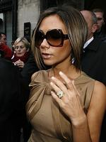 PARIS - JANUARY 24: Victoria Beckham leaves the Jean-Paul Gaultier space after the Jean-Paul Gaultier show, as part of Paris Fashion Week Spring/Summer 2007 on January 24, 2007 in Paris, France. (Photo by Francois Durand/Getty Images)