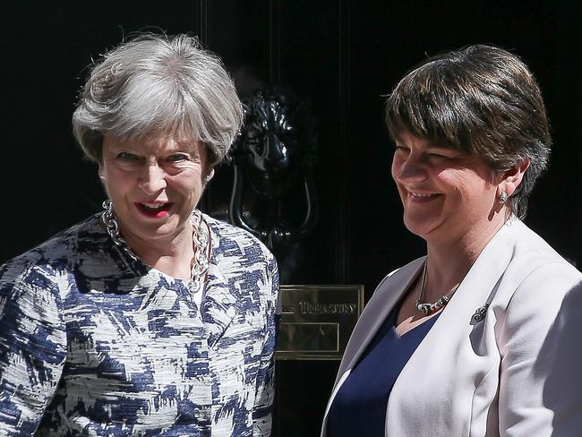 Britain's Prime Minister Theresa May (L) poses for a picture with Democratic Unionist Party (DUP) leader Arlene Foster at 10 Downing Street in central London on June 26, 2017. Picture: AFP.