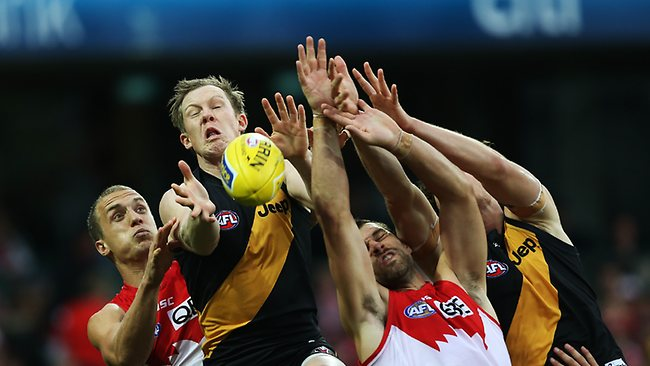 Richmond's Jack Riewoldt attempts to mark ahead of Sydney's Heath Grundy and Ted Richards during AFL match between Sydney Swans v Richmond Tigers at the SCG. Picture: Hillyard Philip