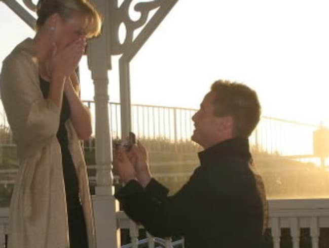 Keith Papini proposes to Sherri in an undated picture. They married in 2008