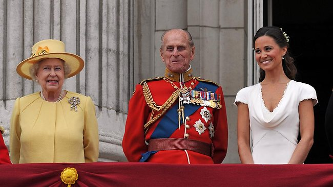 Meet the in-laws: Pippa Middleton joins the Queen and Prince Philip on the balcony. Picture: Getty Images