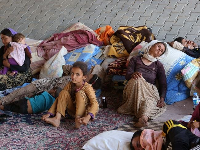 Displaced Iraqis from the Yazidi community settle under a bridge in Dahuk. Pic: AP Photo/ Khalid Mohammed