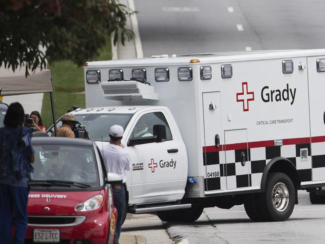 Rare case ... An ambulance transporting Brantly arrives at Emory University Hospital. Picture: David Goldman