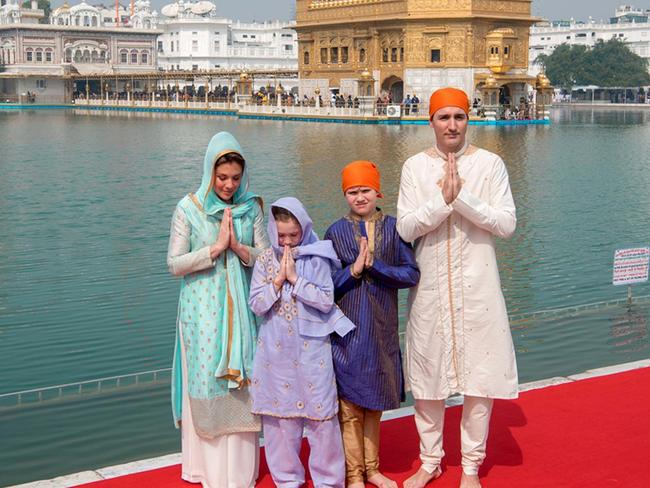 Canada's Prime Minister Justin Trudeau (R), along with his wife Sophie Gregoire Trudeau (L), daughter Ella-Grace (2nd L) and son Xavier (2nd R) pose for a family photo as they pay their respects at the Sikh Golden Temple in Amritsar. Picture: Amritsar District Public Relations Officer.