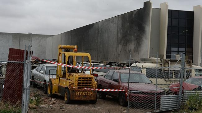 The cordoned-off car-wrecking yard. Picture: Angie Basdekis