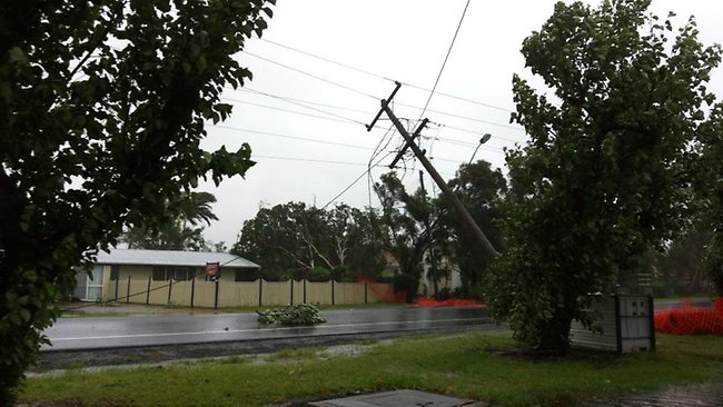 A tornado has ripped through Bargara, tearing roofs off homes, ripping down powerlines and knocking down trees. Emergency crews are on scene and many roads have been closed. Picture: Ergon Enegy Facebook Page