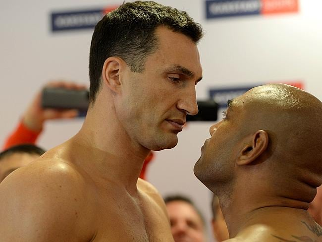 Stare-off ... Ukrainian heavyweight boxing world champion Wladimir Klitschko faces his Australian challenger Alex Leapai during the official weigh-in. Picture: AFP