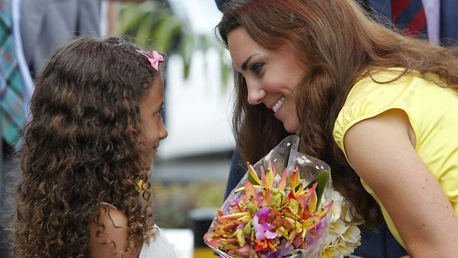 Say it with flowers: The Duchess of Cambridge gets a gift from a young well-wisher.