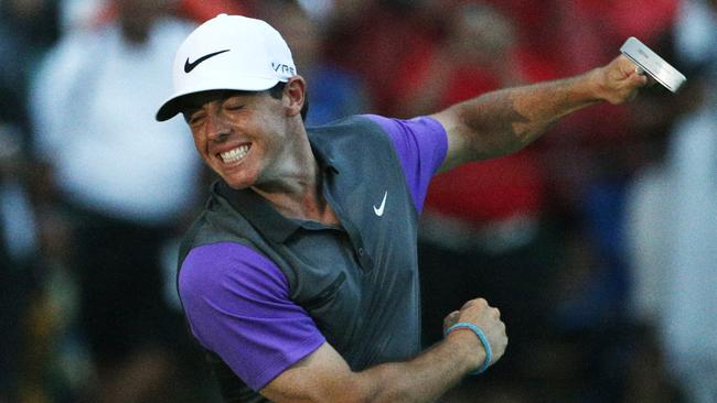 McIlroy starts his celebrations after winning the PGA Championship.