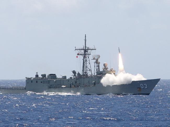 Guided missile frigate ... Missile firing from HMAS Sydney, which is heading to intercept the Russian vessels in the Coral Sea. Picture: RAN