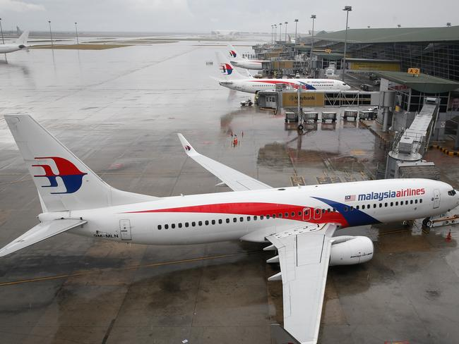 Another blow ... A Malaysia Airlines Boeing 737-800 plane sits on tarmac at Kuala Lumpur International Airport, where the Australian woman's flight departed from.