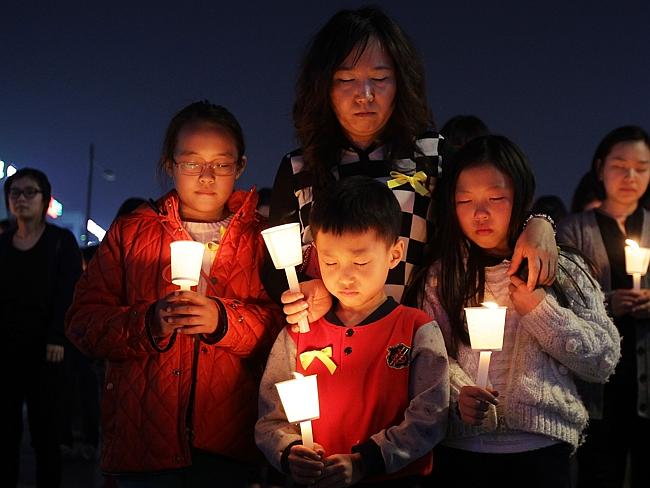 Families Mourn Loss At Group Memorial Altar In Ansan