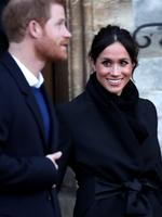 Prince Harry and his fiancee Meghan Markle depart from a walkabout at Cardiff Castle on January 18, 2018 in Cardiff, Wales. Picture: Getty